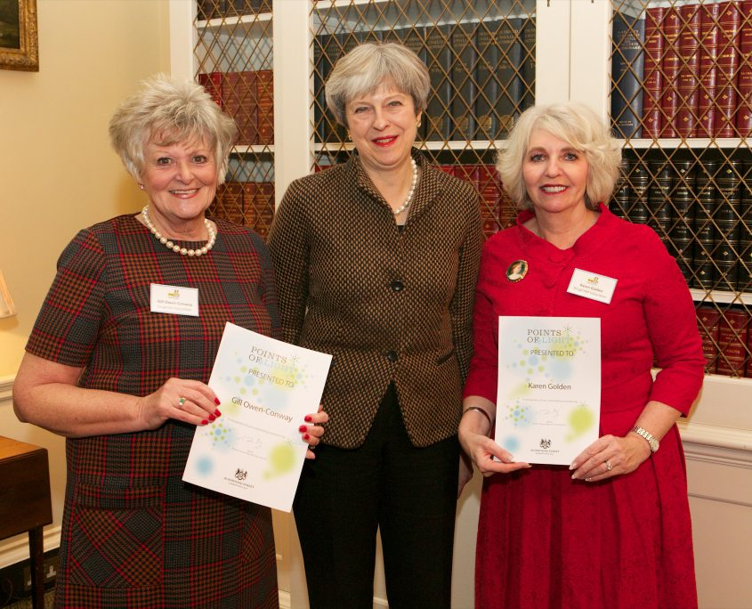 theresa may with the two receivers of the points of light award